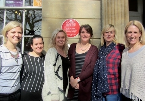 SAFE Link staff celebrating being awarded a Red Nose Plaque for the office.